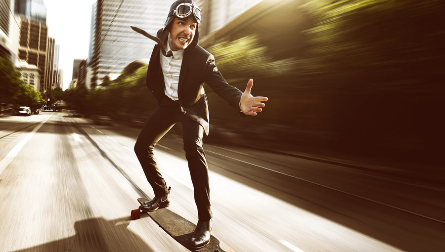 IMAGE-Businessman-on-speeding-skateboard-e1494464341221